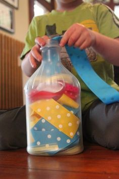 Ribbons. Add a bottle to the mix with ribbons. Let your child work on fine motor skills by pushing ribbons in and out of the bottle.
