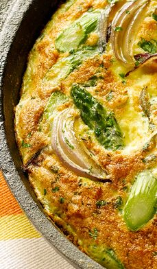 Asparagus and Herb Frittata - Fresh asparagus and onions are sautéed and then blended into a mixture of herbed eggs and Parmesan cheese.