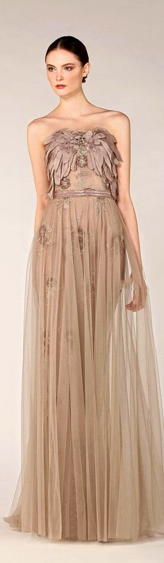 Interesting use of draped petal shapes on this sheer, embroideredTony Ward gown from F/W 2013-2014