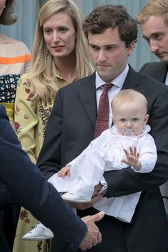Prince Amedeo of Belgium, Archduke of Austria-Este, his wife Archduchess Elisabetta of Austria-Este and their baby daughter Archduchess Anna-Astrid van Oostenrijk-Este arrive at the Music Chapel where Queen Paola celebrates her 80th anniversary on June 29, 2017 in Waterloo, Belgium.