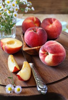 Fresh ripe peaches by photosimysia