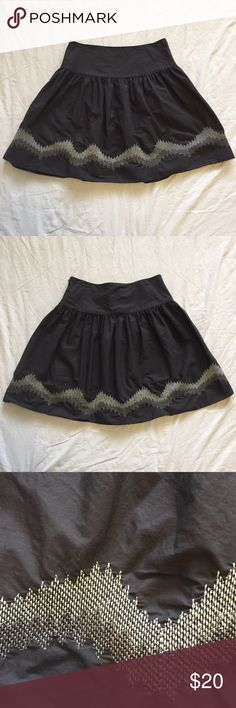 """.GAP. Embroidered charcoal gray skirt Embroidered charcoal gray skirt from GAP. Cute embroidery detail a couple inches above hem. Skirt is dark gray, and embroidery is silver and metallic gray. 100% cotton. Hook is slightly bent out of shape (see photo), otherwise EUC. Size 6R. Laying flat, waist measures 15"""". Length is 20"""". B. GAP Skirts"""