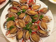 Fried abolone, abalone on a plate, fried abalone with garlic and chilly