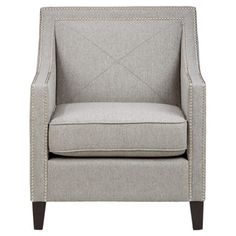 Showcasing eye-catching nailhead trim and a welted cushion, this elegant arm chair brings stylish appeal to your living room or home library. ...