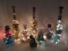 Up Cycled Glass Bottle Lights Collection of recycled glass bottles crafted into amazing home decor lighted bottles. I have a table top drill... Jar Crafts, Home Crafts, Diy Home Decor, Coastal Decor, Bottles And Jars, Lighted Wine Bottles, Bottle Lights, Liquor Bottles, Bottle Lamps