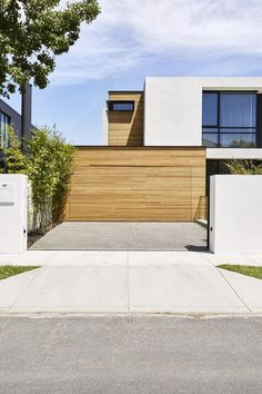'Howitt' residence by mckimm IRON ASH cladding used to clad the garage and side wall. Photography - Dave Kulesza