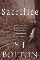 Sacrifice by S.J. Bolton.  A bone chilling, spellbinding debut novel set on a remote Shetland island where surgeon Tora Hamilton makes the gruesome discovery, deep in peat soil, of the body of a young woman, her heart brutally torn out.