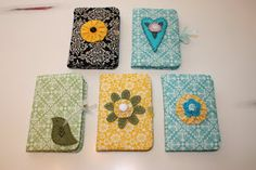 I love these fabric covered notepads....could redo these for my e-reader!