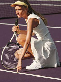 Pink Tartan dress, $425. Dorfman Pacific visor, $15. Geneva watch. K-Swiss sneakers, $60. Chanel racquet.
