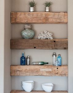 Reclaimed solid wood support beams add a rustic touch that is both modern and contemporary when used for chunky shelves