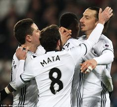 Zlatan Ibrahimovic is mobbed by his team-mates after finding the net at West Ham
