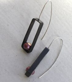 Oxidized sterling silver hand soldered/hammered frames. 7mm pink/purple freshwater pearls. Just over 1.5 inch hang length.