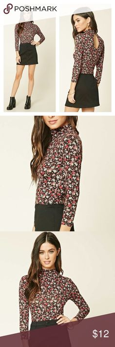 Forever 21 Floral Mock Neck Top Floral Mock-Neck Crop Top A stretch-knit floral print crop top with a mock neckline, a buttoned keyhole back, and 3/4 sleeves. Forever 21 Tops Crop Tops