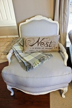 Love everything about this chair - the style, the white paint, the ticking stripe, the throw, the pillow....