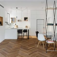 Frea Home Factory comment: love the herringbone flooring and the delicate structure of the roomdivider Maayan+Zusman+warms+up+Tel+Aviv+apartment+with+herringbone+flooring