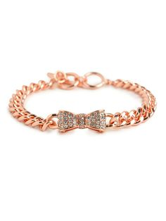 Tough-chic chains get a shot of the sweet stuff in this lovely statement bracelet. It features a cool mix of chunky links and a charming pavé bow accent — all cast in beautiful rose gold. $24 @Ingrid Taylor Taylor