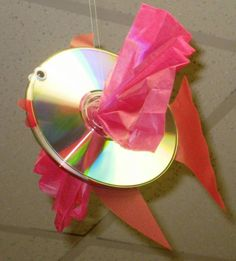 You can make this beautiful fish from an old CD or DVD!  It is fun to think of new and creative ways to reuse and recycle old household items.