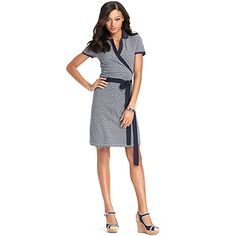 """Tommy Hilfiger women's dress. It's a wrap in our signature logo print dress. A universally flattering silhouette crafted in stretchy pique cotton plus an attached belt. br/• Classic fit. Approximately 37"""" from shoulder to hem.br/• 94% cotton, 6% elastane.br/• Microflag on chest.br/• Machine washable.br/• Imported.br/"""