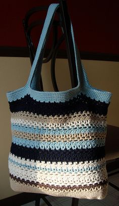 I have so much excess yarn and nowhere to put it. I should make one of these bags out of yarn that I already have and then use it to contain all of my other yarn that's lying around the house.