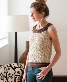 This is crocheted, but inspires me with the contrast yoke and band, bold stitch pattern contrasts too