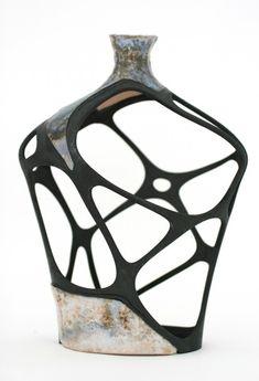 A digitally restored broken vase, glazed ceramic, SLS nylon element, epoxy glue and black spray paint, 2010. (© Amit Zoran) --