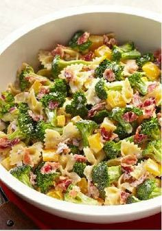 Tangy Broccoli-Pasta Salad – Broccoli florets, crumbled bacon, chopped peppers and bow-tie pasta. Only 25 minutes to prep this colorful salad recipe!