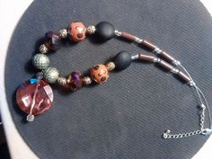 multicolor beads and glass necklace.