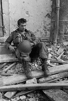 U. S. Soldier catching his breath in Saint-Sauveur - Le-Vicomte, June 16, 1944