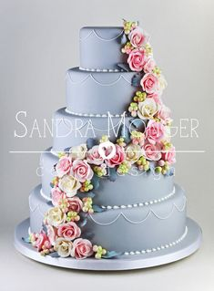 Dove Grey Classic Wedding Cake with Handmade Roses, Snowberries and Dusty Miller Leaves.