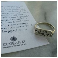 Dogeared I Am Happy Sterling Silver Ring Sterling silver ring with 17mm 'I Am Happy' dog tag. New in package with message card. Made jn USA. Size 7. Dogeared Jewelry Rings