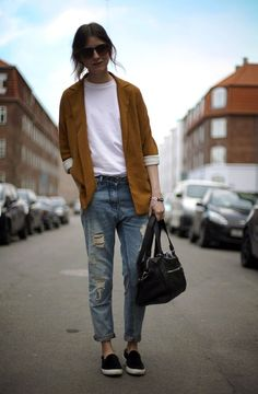 Shop this look on Lookastic:  https://lookastic.com/women/looks/blazer-crew-neck-t-shirt-boyfriend-jeans-slip-on-sneakers-duffle-bag-sunglasses/8322  — White Crew-neck T-shirt  — Dark Brown Sunglasses  — Tobacco Blazer  — Light Blue Ripped Boyfriend Jeans  — Black Canvas Duffle Bag  — Black Suede Slip-on Sneakers