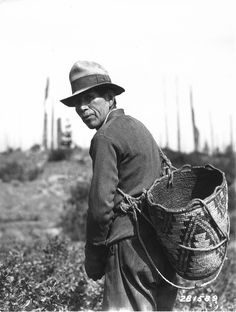 Indian man with huckleberry basket by OSU Special Collections & Archives : Commons, via Flickr