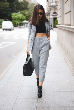 Carla Estévez Marcos is wearing a grid pattern grey suit from Urban Outfitters, boots from Zara, top from Mango and the bag is from Lolita Blu