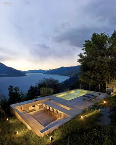 In Brissago, Switzerland, the kitchen of a vacation house by Wespi de Meuron Romeo Architetti overlooks Lago Maggiore.Photography by James Silverman.