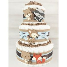 "Woodland diaper cakes are a unique and affordable way to ""WOW!"" your favorite mother-to-be.  These woodland baby shower gifts will add the perfect touch to any woodland themed baby shower! Get yours here:"