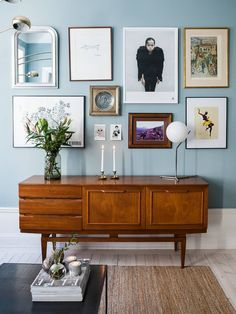 Love this mid century sideboard against the pale blue wall