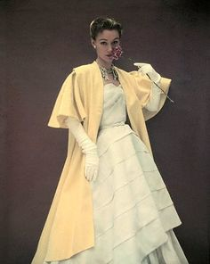 Sophie Malgat in a strapless evening gown with yellow mantle by Biki of Milan, Paris 1952