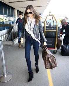 Miranda Kerr leaving LA with a Louis Vuitton Damier duffle bag.