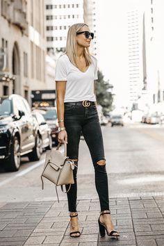 71ed4156531 Blonde Woman Waering White Tshirt Black Ripped Skinny Jeans Gucci Marmont  Belt Black Ankle Strap Heeled