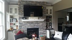 Echo Ridge Southern Ledgestone by Boral Cultured Sotne with wood mantel and wall mount TV