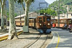 Train to Sóller (Spain). 'Palma and Sóller rank highly as attractions in their own right, but the antique wooden train  that ambles between them is an utterly charming way to travel. The train forsakes the  clamour of city life, passing through quiet scenes of rural Mallorca before climbing into the foothills,  looking for a way through the Serra de Tramuntana.' http://www.lonelyplanet.com/spain/mallorca/activities/train/tren-de-soller