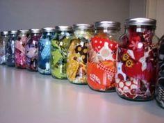 Fabric organized by color in repurposed mason jars!