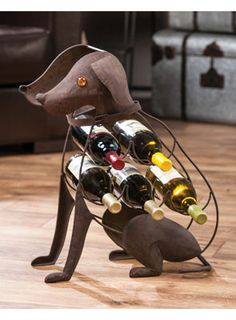 Dog Wine Rack for $135.00 from WineRacks.com  Dimensions: 17.5 w x 9d x 20.5 h Capacity: 5 bottles  Let this trusty hound hold your wine. Rustic brown metal finish.