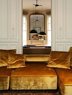 This caramel/gold velvet is just exquisite! We adore the concept of this home, the beautiful classy doors, amazing light installation and the depth effect created by the mirror.