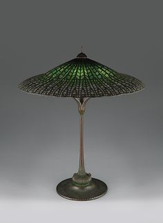 """Tiffany Studios, New York, Favrile Leaded Glass and Patinated Bronze """"Lotus"""" Lamp."""