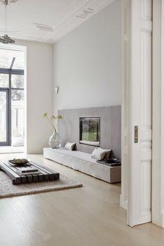 Tranquil grey living room. Fireplace. Minimalist. Modern. Concrete. Wood. Asian. Decor. Interior Design. High Ceilings. Sliding Door.