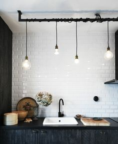 I like this so much, I may have previously pinned it, but in case not ... Wrapped around a metal rod, they're transformed into a sort of messy chandelier. It's a simple solution that's quite eye-catching