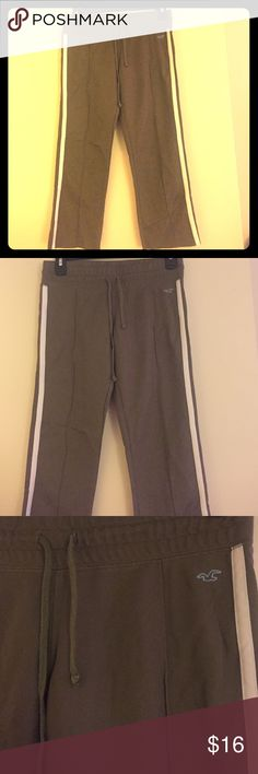 Hollister Olive Green Capris Olive Green capris by Hollister. Baby blue lettering on the bum. White stripes down the side of both pant leg. Low rise wear. Hollister Pants Capris