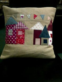 Applique cushion with houses and bunting by Kraftysues on Etsy, £18.00