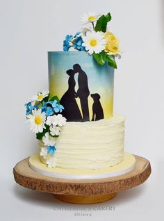 This cake is truly a canvas for beautiful art by Catherine's Cakery
